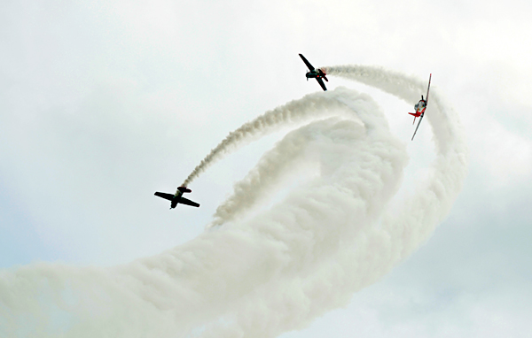 Air planes racing at a demonstration.